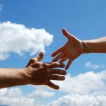 solidarity-sky-handshake-man-woman-clouds-blue