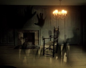 shadows-of-hands-and-humans-in-gloomy-room
