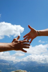 solidarity-sky-handshake-man-woman-clouds-blue
